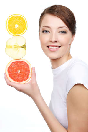 citrous: beauty portrait of young laughing woman with citrous fruits