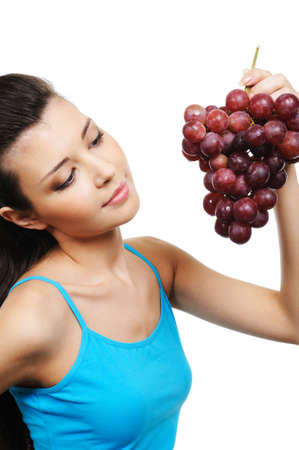 young attractive woman holding a bunch of grapes - white background photo