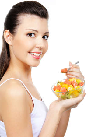 citrous: attractive young laughing girl eating fruit  citrous dessert