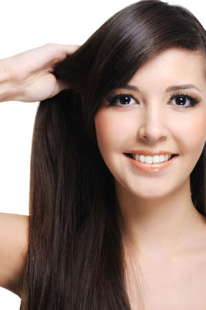 healthy thick straight hair of young beautiful woman photo