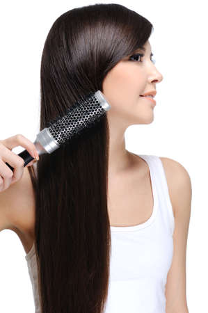 young beautiful woman do her long straight healthy hair  photo