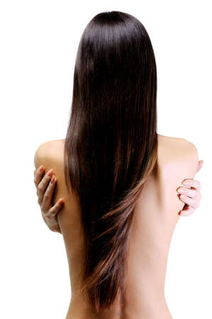 wind blown hair: rear view of slender young woman with beautiful long straight hair Stock Photo