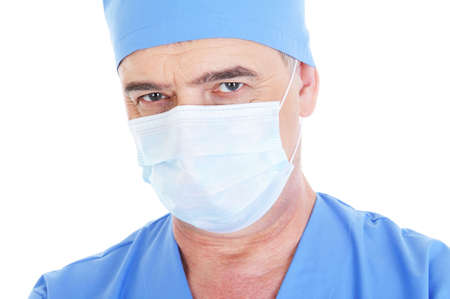 portrait of mature male surgeon in medical mask  - isolated on white photo