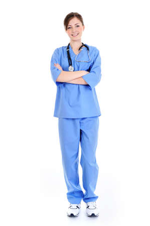 female surgeon: young laughing female surgeon in blue uniform full-length