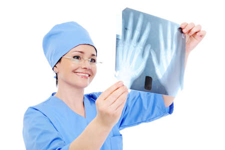 roentgenogram: cheerful female doctor  looking on the X-ray - studio Stock Photo