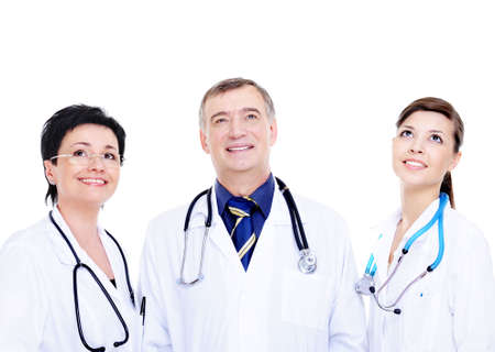 portrait of three laughing successful doctors looking up - isolared photo