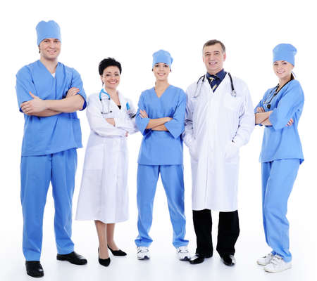 alternate: happy successful doctors standing together and alternate in uniform and hospital gown   Stock Photo