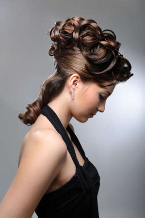grey hair female: Profile portrait of a female model with beautiful  wedding hairstyle.