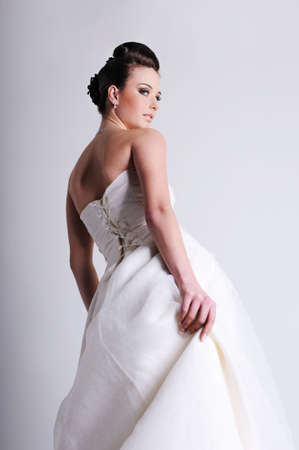 see side: half-turned of bride dressed in white wedding dress  Stock Photo
