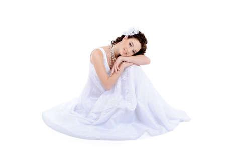Beautiful young woman in white wedding dress photo