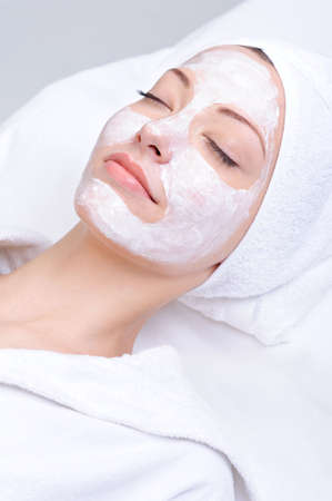 skincare facial: relaxation of young beautiful girl in the spa salon