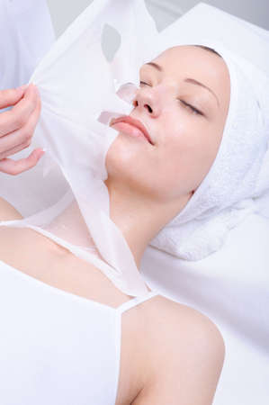 remove: facial care of young beautiful girl in  the spa salon