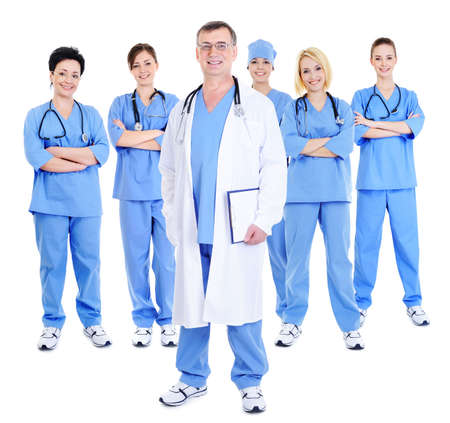 command: happy successful command of surgeons with one mature doctor in the foreground Stock Photo