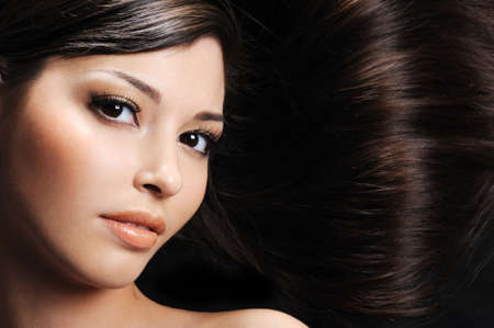 close-up beautiful female face with beautiful healthy long hairs photo