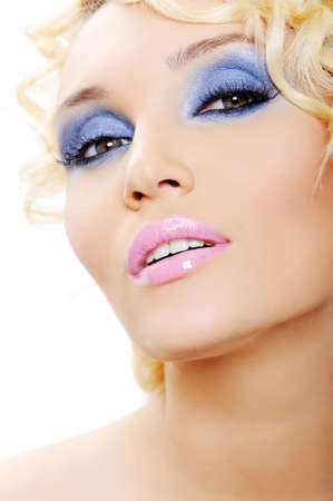 sensuality young female face with bright shine blue make-up