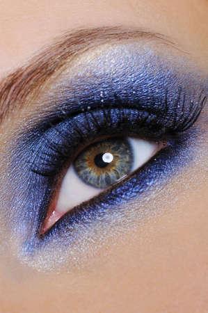 eyeliner: human female eye with bright make-up on it - close-up
