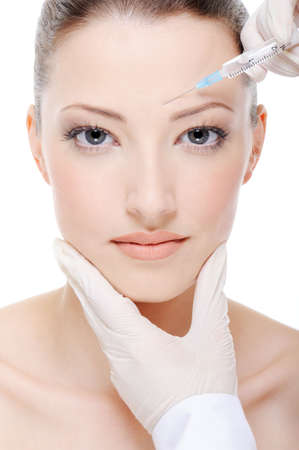 beautician giving an injection on the young female face Stock Photo - 4863830