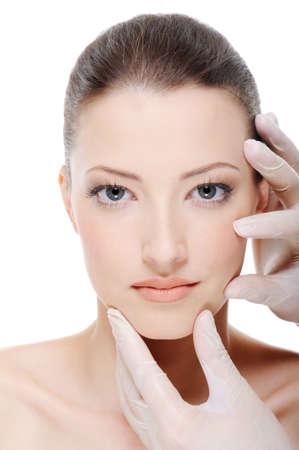 beautician touching perfect famel face Stock Photo