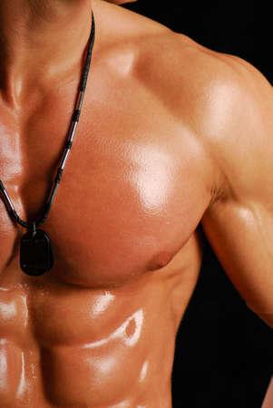 torso: Part of beauty male torso. Isolated on back. Stock Photo
