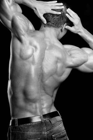 back views: beautiful shape of men back isolated on black background. Stock Photo