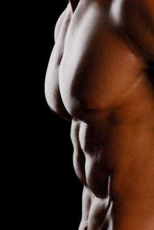 Part of beautiful male torso. Isolated on back. Side view Stock Photo - 4871384