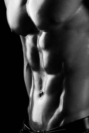 abdominal muscles: Beauty men torso. body. Isolated on black. Stock Photo