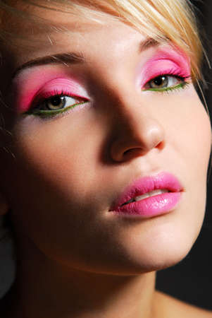 Face of beauty girl with bright pink ceremonial make-up photo