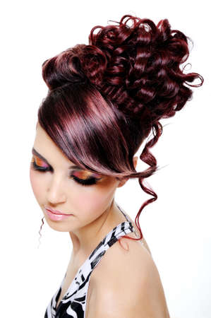 fashion creative hairstyle on the head of the young beautiful woman photo
