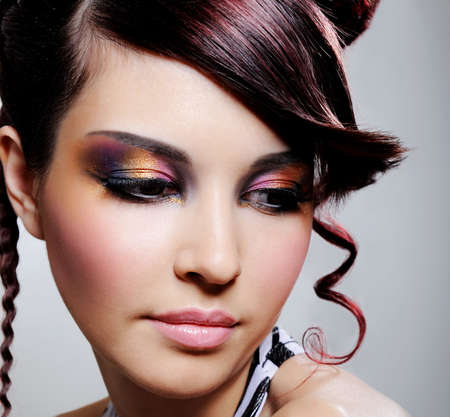 beautiful pretty female face with multicoloured eyeshadow - close-up