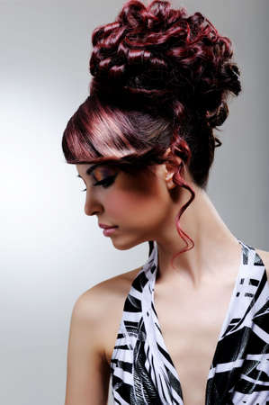 elegancy: creative fashion female hairstyle - profile of young woman Stock Photo
