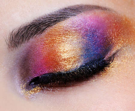 human closed eye with multicoloured eyeshadow - macro shoot Stock Photo - 4871418