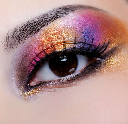 bright multicoloured make-up on the female eye - macro shoot Stock Photo - 4871437
