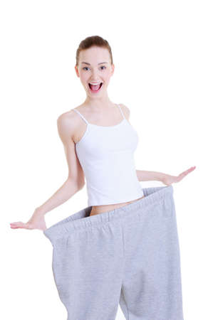 slender young pretty girl on the large trousers after diet Stock Photo - 4881850