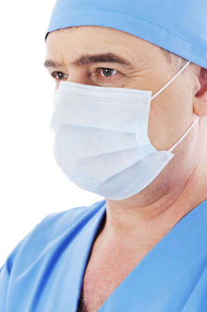 portrait of mature male doctor surgeon with mask on his face photo