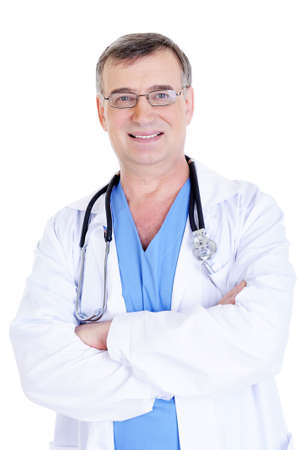 portrait of cheerful successful male doctor with stethoscope and in hospital gown photo
