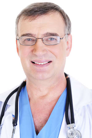 portrait of happy senior male doctor with toothy smile and with eyeglasses photo