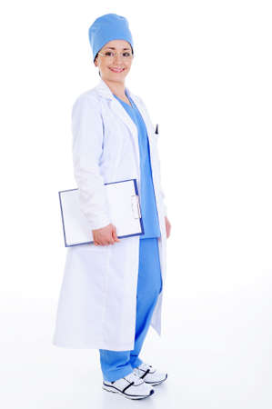 successful cheerful female surgeon in hospital gown with documents photo