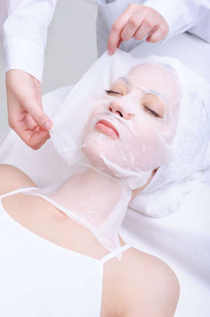 young beautiful woman in the beauty cosmetic salon - indoors photo