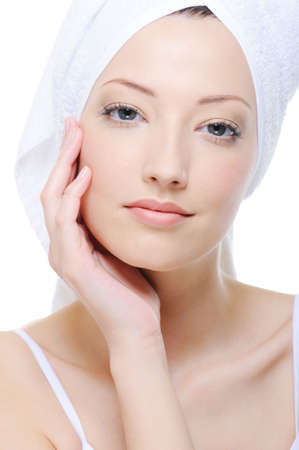 young beautiful woman stroking her clean attractive face photo