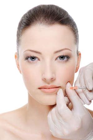 injection of botox on female lips - female portrait photo