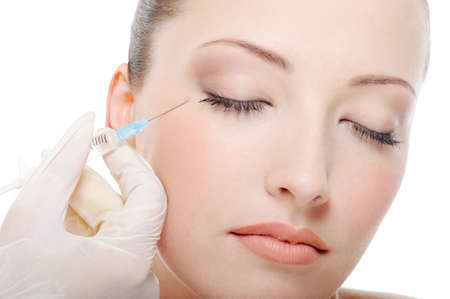 botox injection for the beautiful young woman photo