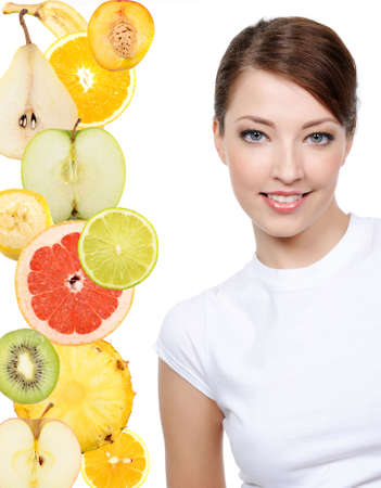 cut fruit: Pretty young woman face with slices of  citrus fruits