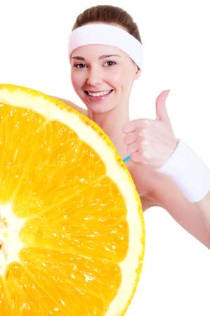 citrous: Smiling young girl in healthy lifestyle concept with big orange