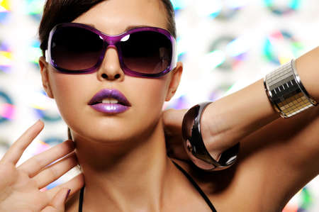 feminity: portrait of expressive beautiful young woman with stylish sunglasses Stock Photo