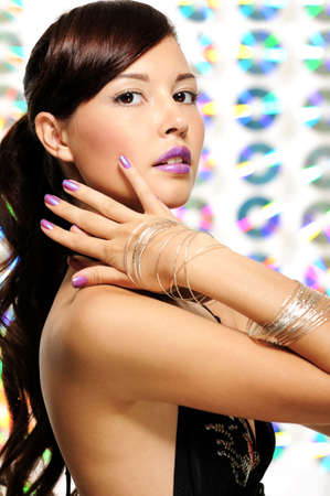 beautiful expressive woman with violet lipstick and violet nail varnish photo