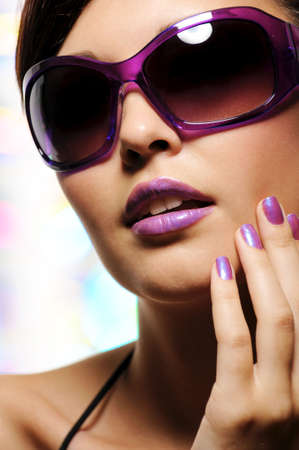glamour portrait of beautiful young woman in big violet fashion sunglasses photo
