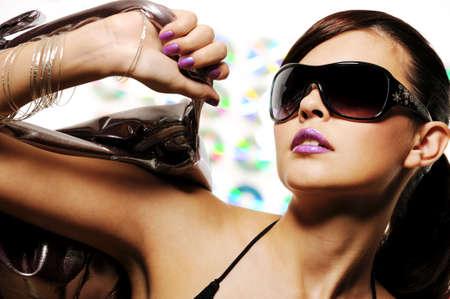 bright beautiful young woman with fashion sunglasses and handbag Stock Photo - 5147574