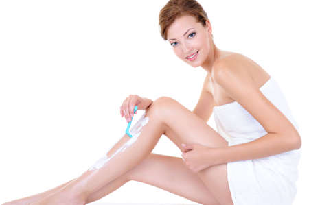 shave: beautiful adult caucasian woman shaving legs with razor - isolated