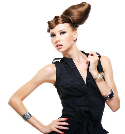 Beautiful caucasian woman dressed in black fashionable dress posing at studio Stock Photo - 5169371