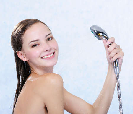 Beautiful attractive happy girl taking shower Stock Photo - 5204282